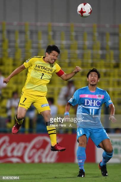 Hidekazu Otani of Kashiwa Reysol and Yohei Toyoda of Sagan Tosu compete for the ball during the JLeague J1 match between Kashiwa Reysol and Sagan...
