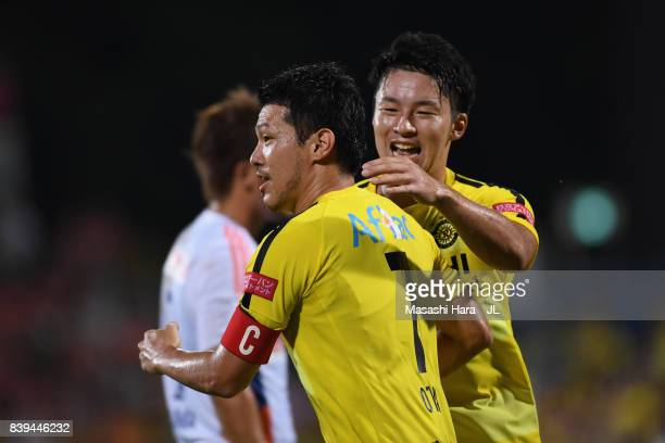Hidekazu Otani of Kashiwa Reysol celebrates scoring his side's first goal with his team mate Yuta Nakayama during the JLeague J1 match between...