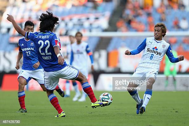 Hideki Ishige of Shimizu SPulse and Yuji Nakazawa of Yokohama FMarinos compete for the ball during the JLeague match between Yokohama FMarinos and...
