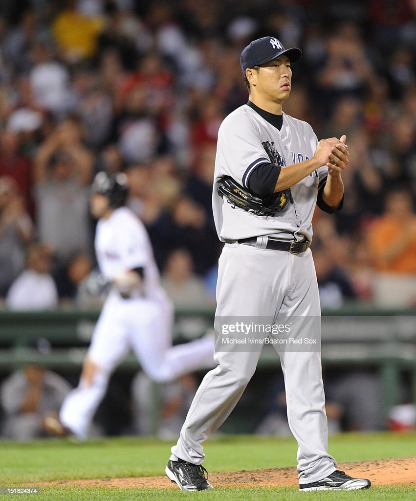 Hideki Kuroda #55 of the New York Yankees walks back to the mound after giving up a home run to Dustin Pedroia #15 of the Boston Red Sox in the sixth inning on September 11, 2012 at Fenway Park in Boston, Massachusetts.