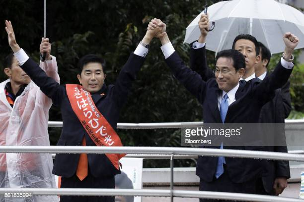 Hideki Makihara a member of the Liberal Democratic Party second from left and Fumio Kishida chairman of the Policy Research Council at the LDP and...