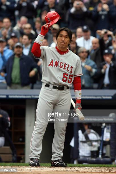 Hideki Matsui of the Los Angeles Angels of Anaheim acknowledges the fans before batting against the New York Yankees during the Yankees home opener...