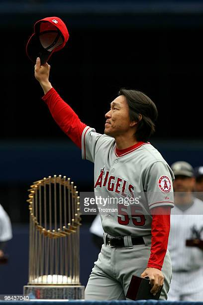 Hideki Matsui of the Los Angeles Angels of Anaheim acknowledges the fans after he received his World Series ring for being a member of the 2009 New...