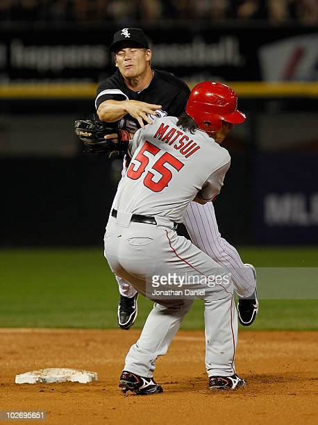 Hideki Matsui of the Los Angeles Angels of Anaheim collides with Gordan Beckham of the Chicago White Sox as Beckham turns a double play at US...