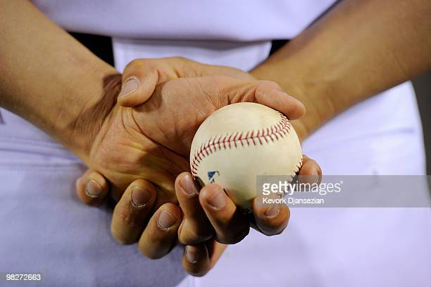 Hideki Matsui of the Los Angeles Angels of Anaheim holds his home run ball following their 63 win over the Minnesota Twins on Opening Day at Angel...