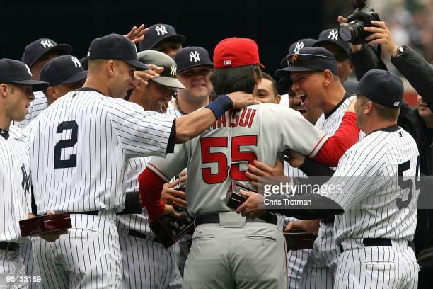 Hideki Matsui of the Los Angeles Angels of Anaheim is greeted by former teammates including Derek Jeter and Alex Rodriguez of the New York Yankees...