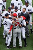 Hideki Matsui of the Los Angeles Angels of Anaheim is greeted by former teammates Alex Rodriguez Derek Jeter Jorge Posada Robinson Cano Joba...