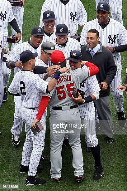 Hideki Matsui of the Los Angeles Angels of Anaheim is greeted by former teammates Alex Rodriguez Derek Jeter Jorge Posada Robinson Cano Joba...