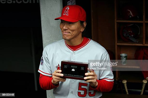 Hideki Matsui of the Los Angeles Angels of Anaheim poses after receiving his World Series ring for being a member of the 2010 New York Yankees...