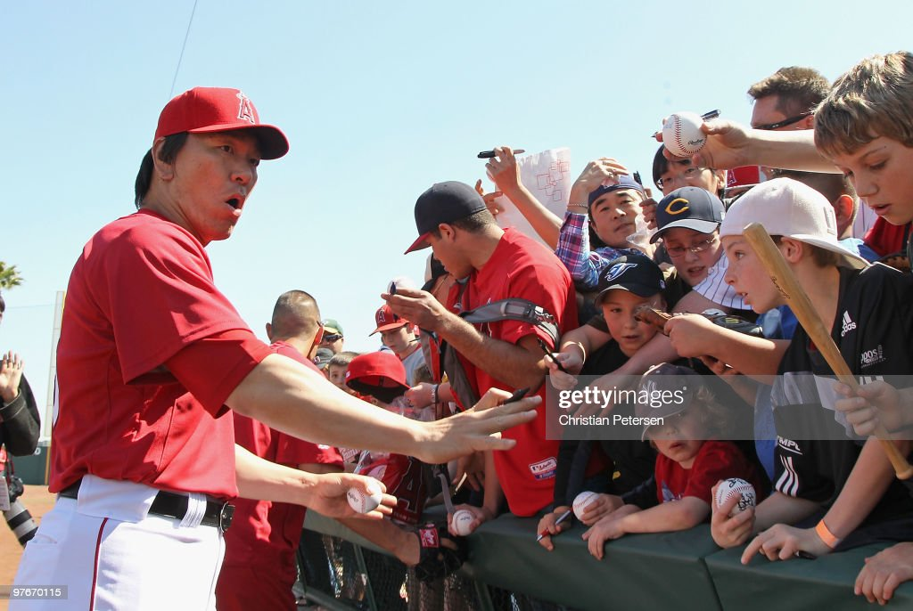 Hideki Matsui #55 of the Los Angeles Angels of Anaheim reacts as the fence holding back fans breaks before the MLB spring training game against the Chicago White Sox at Tempe Diablo Stadium on March 12, 2010 in Tempe, Arizona.