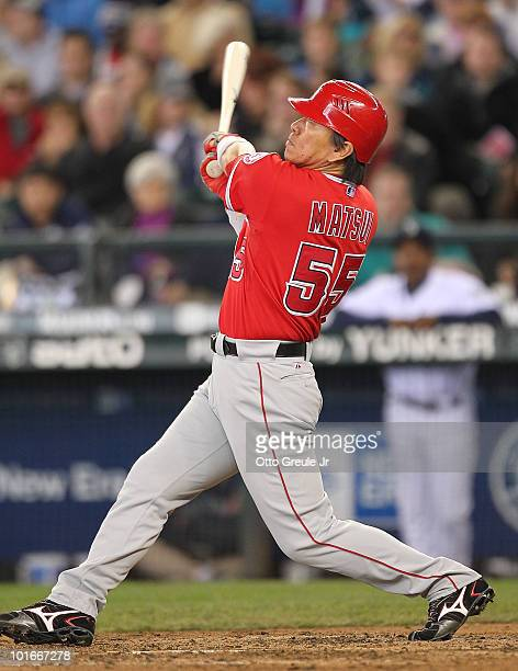Hideki Matsui of the Los Angeles Angels of Anaheim watches his home run in the fifth inning against the Seattle Mariners at Safeco Field on June 6...