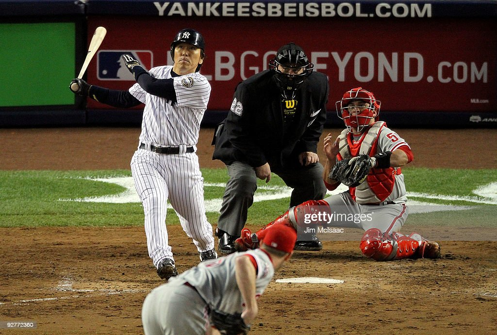 <a gi-track='captionPersonalityLinkClicked' href=/galleries/search?phrase=Hideki+Matsui&family=editorial&specificpeople=157483 ng-click='$event.stopPropagation()'>Hideki Matsui</a> #55 of the New York Yankees hits a 2-run double in the bottom of the fifth inning against the Philadelphia Phillies in Game Six of the 2009 MLB World Series at Yankee Stadium on November 4, 2009 in the Bronx borough of New York City.