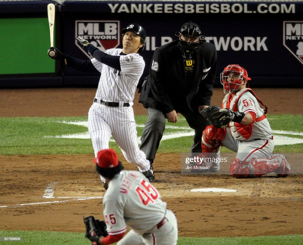 <a gi-track='captionPersonalityLinkClicked' href=/galleries/search?phrase=Hideki+Matsui&family=editorial&specificpeople=157483 ng-click='$event.stopPropagation()'>Hideki Matsui</a> #55 of the New York Yankees hits a 2-run home run in the bottom of the second inning against the Philadelphia Phillies in Game Six of the 2009 MLB World Series at Yankee Stadium on November 4, 2009 in the Bronx borough of New York City.