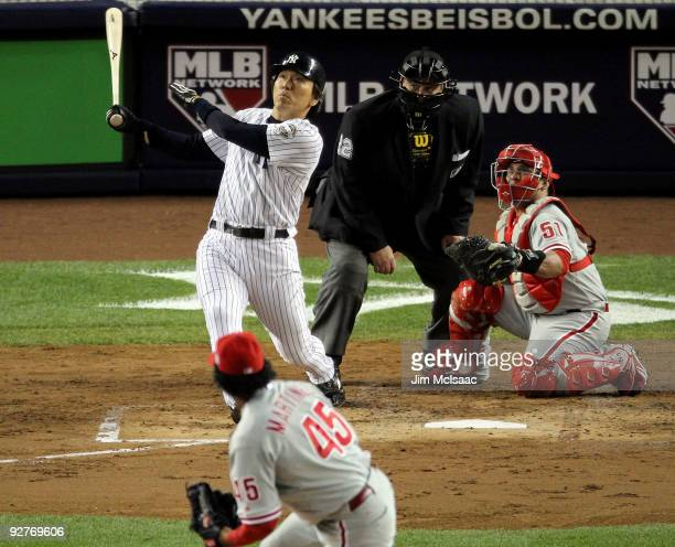Hideki Matsui of the New York Yankees hits a 2run home run in the bottom of the second inning against the Philadelphia Phillies in Game Six of the...