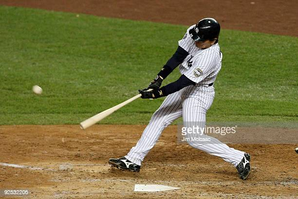 Hideki Matsui of the New York Yankees hits a solo home run in the sixth inning against the Philadelphia Phillies at Yankee Stadium on October 29 2009...