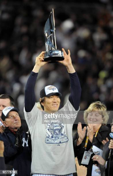 Hideki Matsui of the New York Yankees holds up the World Series MVP trophy after the Yankees 73 win against the Philadelphia Phillies in Game Six of...