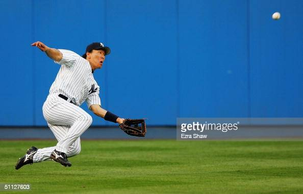 Hideki Matsui of the New York Yankees makes a diving catch on a ball hit by Karim Garcia of the Baltimore Orioles in the third inning on July 29 2004...