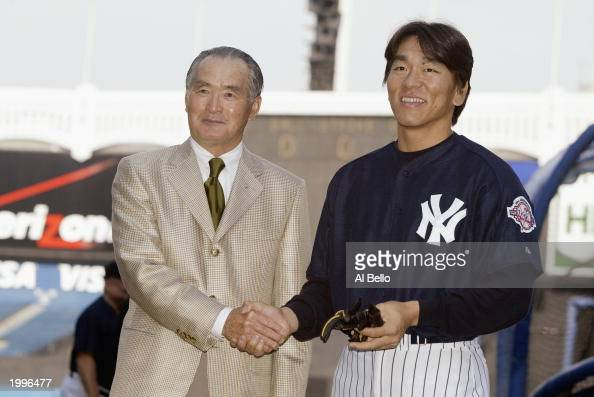 Hideki Matsui of the New York Yankees poses with former manager Shigeo Nagashima of the Yomiyuri Giants before the game against the Seattle Mariners...