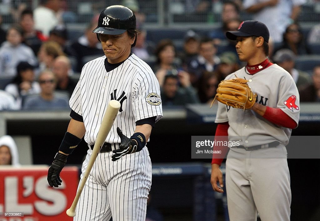 <a gi-track='captionPersonalityLinkClicked' href=/galleries/search?phrase=Hideki+Matsui&family=editorial&specificpeople=157483 ng-click='$event.stopPropagation()'>Hideki Matsui</a> #55 of the New York Yankees reacts after popping out with the base loaded against <a gi-track='captionPersonalityLinkClicked' href=/galleries/search?phrase=Daisuke+Matsuzaka&family=editorial&specificpeople=797706 ng-click='$event.stopPropagation()'>Daisuke Matsuzaka</a> #18 of the Boston Red Sox on September 26, 2009 at Yankee Stadium in the Bronx borough of New York City.