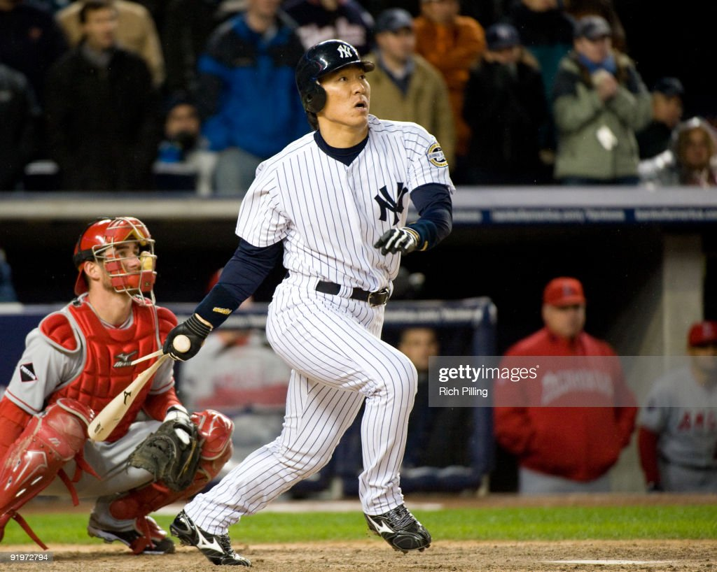 <a gi-track='captionPersonalityLinkClicked' href=/galleries/search?phrase=Hideki+Matsui&family=editorial&specificpeople=157483 ng-click='$event.stopPropagation()'>Hideki Matsui</a> #55 of the New York Yankees singles in the ninth inning of Game Two of the ALCS against the Los Angeles Angels of Anaheim during the 2009 MLB Playoffs at Yankee Stadium on October 17, 2009 in the Bronx borough of New York City.