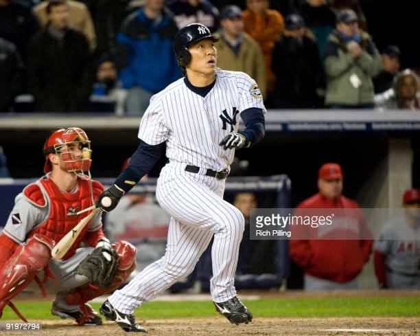 Hideki Matsui of the New York Yankees singles in the ninth inning of Game Two of the ALCS against the Los Angeles Angels of Anaheim during the 2009...