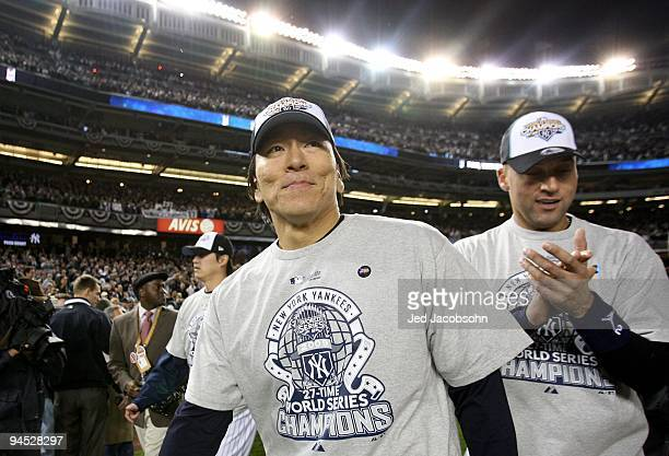 Hideki Matsui of the New York Yankees stands on the field with Derek Jeter after their 73 win against the Philadelphia Phillies in Game Six of the...