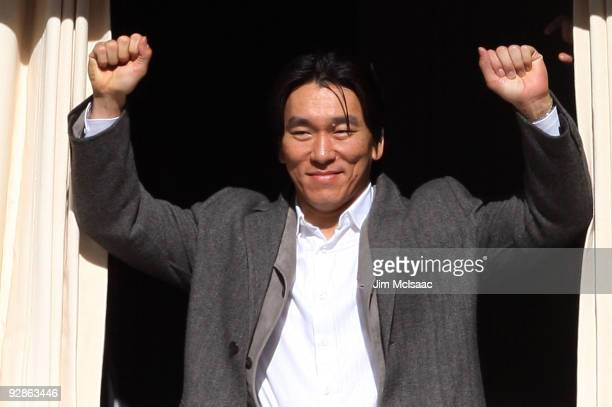 Hideki Matsui of the New York Yankees waves to the crowd during the New York Yankees World Series Victory Celebration at City Hall on November 6 2009...