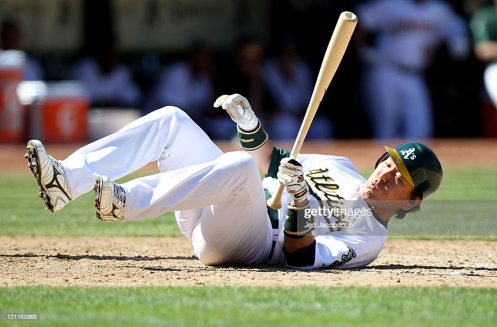 <a gi-track='captionPersonalityLinkClicked' href=/galleries/search?phrase=Hideki+Matsui&family=editorial&specificpeople=157483 ng-click='$event.stopPropagation()'>Hideki Matsui</a> #55 of the Oakland Athletics is knocked down by a pitch against the Texas Rangers at O.co Coliseum on August 14, 2011 in Oakland, California.