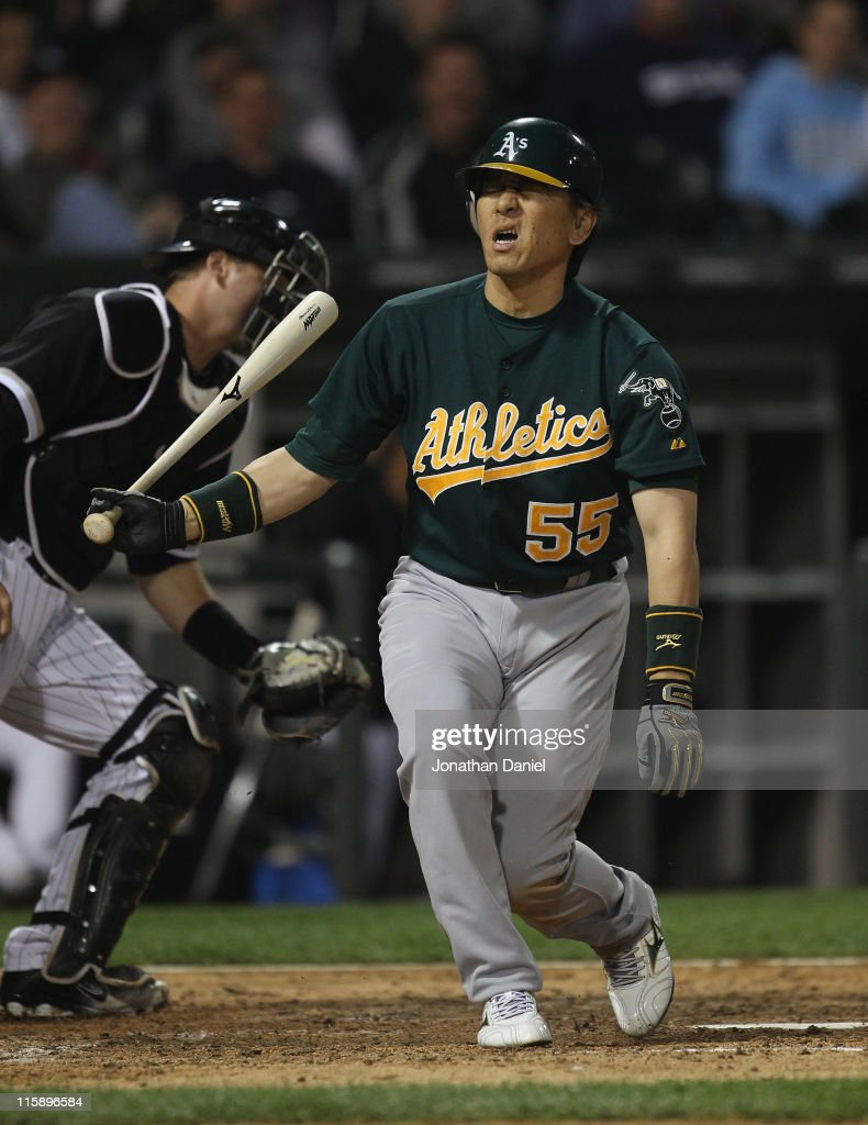 Hideki Matsui #55 of the Oakland Athletics reacts after striking out to end the 7th inning against the Chicago White Sox with teammates at U.S. Cellular Field on June 10, 2011 in Chicago, Illinois. The Athletics defeated the White Sox 7-5.
