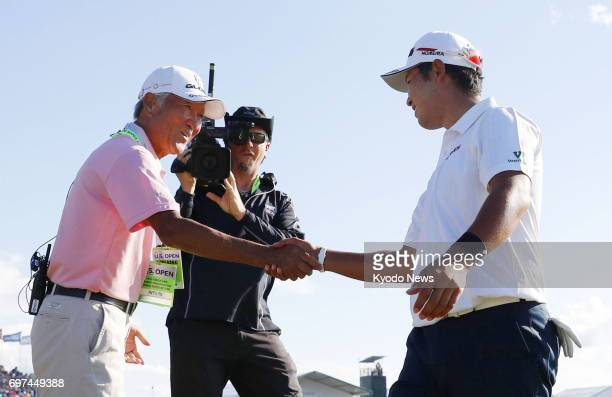 Hideki Matsuyama is congratulated by World Golf Hall of Famer Isao Aoki after finishing in a tie for second with a total score of 12under 276 at the...