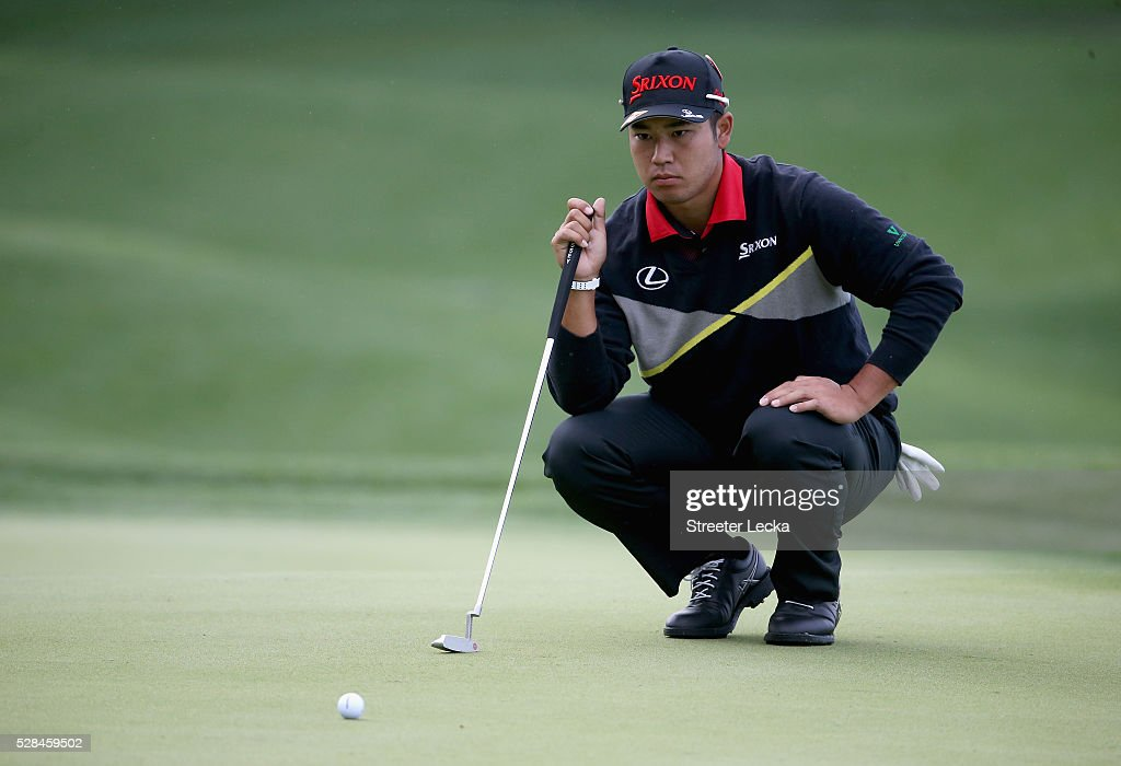 Hideki Matsuyama lines up a putt on the 14th hole during the first round of the 2016 Wells Fargo Championship at Quail Hollow Club on May 5, 2016 in Charlotte, North Carolina.