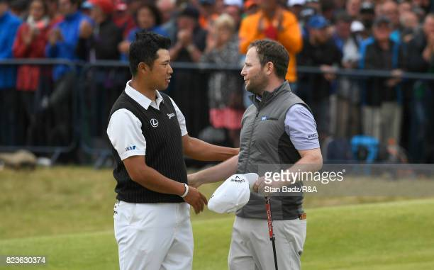 Hideki Matsuyama of Japan and Branden Grace of South Africa shakehands on the 18th green during the final round of the 146th Open Championship at...