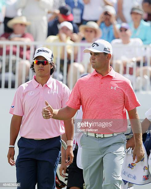 Hideki Matsuyama of Japan and Gary Woodland of the United States walk together on the tenth hole during the first round of the BMW Championship at...