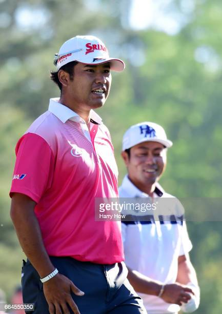 Hideki Matsuyama of Japan and Hideto Tanihara of Japan walk off the 12th tee during a practice round prior to the start of the 2017 Masters...