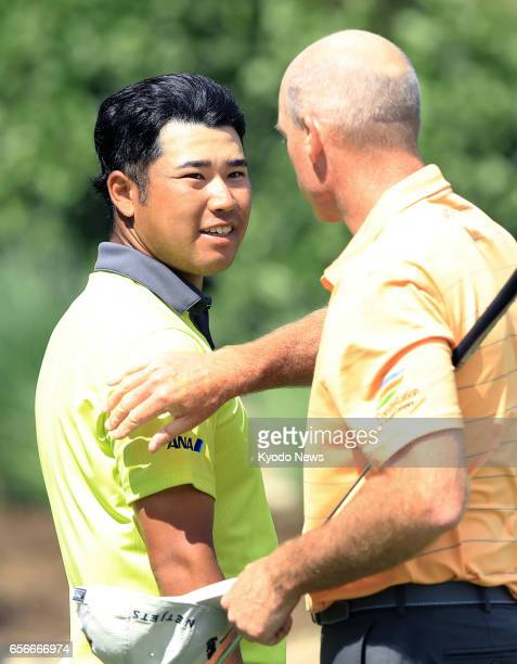Hideki Matsuyama of Japan and Jim Furyk of the United States are seen after halving in a group on the first of a threeday roundrobin group at the...