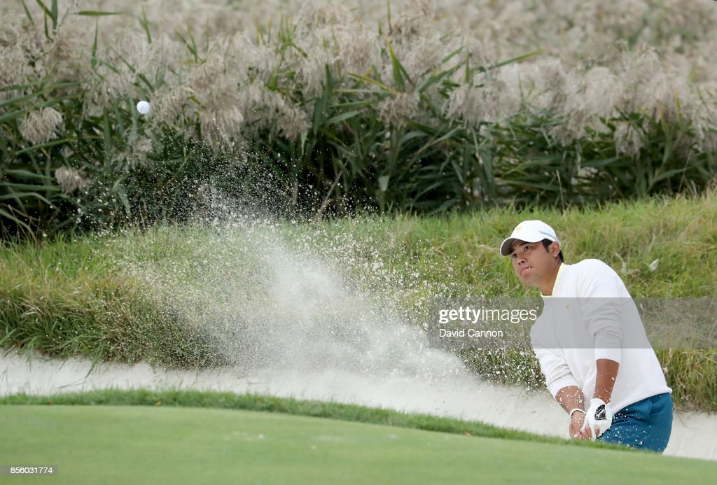 Hideki Matsuyama of Japan and the International team plays his second shot on the 10th hole in his match with Jhonattan Vegas against Daniel Berger and Justin Thomas of the United States team during the Saturday afternoon fourball matches in the 2017 Presidents Cup at the Liberty National Golf Club on September 30, 2017 in Jersey City, New Jersey.