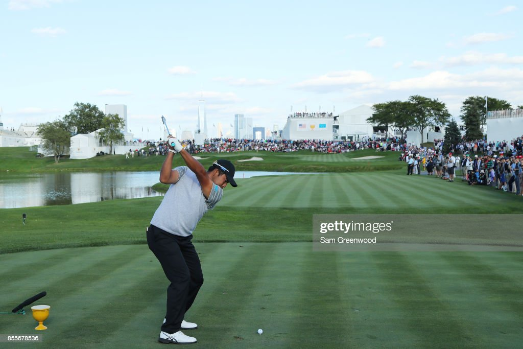 Hideki Matsuyama of Japan and the International Team plays his shot from the 18th tee during Friday four-ball matches of the Presidents Cup at Liberty National Golf Club on September 29, 2017 in Jersey City, New Jersey.