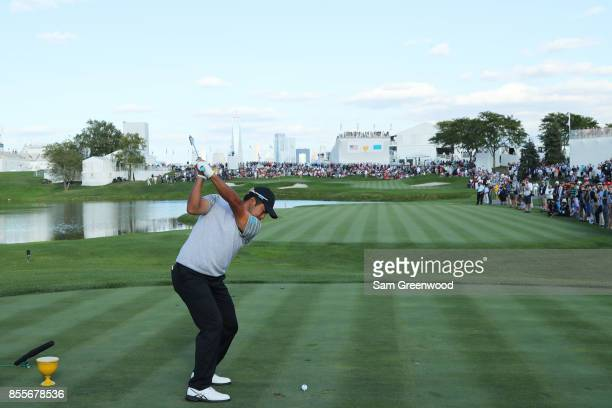 Hideki Matsuyama of Japan and the International Team plays his shot from the 18th tee during Friday fourball matches of the Presidents Cup at Liberty...