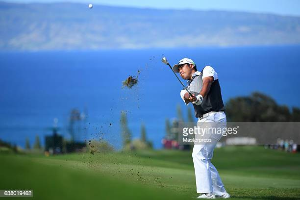 Hideki Matsuyama of Japan attempts a chipin eagle on the 14th hole during the final round of the SBS Tournament of Champions at the Plantation Course...