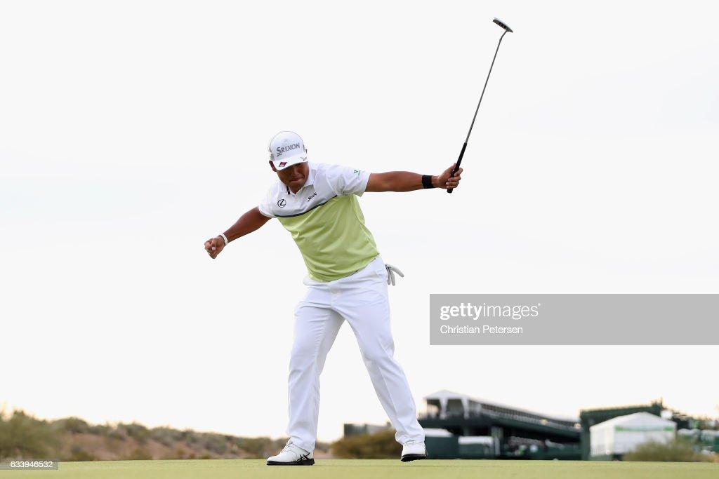 Hideki Matsuyama of Japan celebrates after winning the Waste Management Phoenix Open on the fourth playoff hole at TPC Scottsdale on February 5, 2017 in Scottsdale, Arizona.