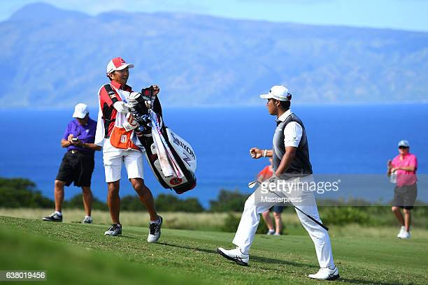 Hideki Matsuyama of Japan celebrates his chipin eagle on the 14th hole during the final round of the SBS Tournament of Champions at the Plantation...