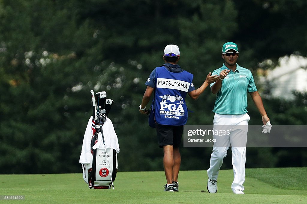 Hideki Matsuyama of Japan celebrates holing out for eagle on the second hole with caddie Daisuke Shindo during the second round of the 2016 PGA...