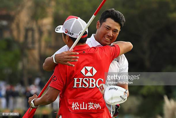Hideki Matsuyama of Japan celebrates victory with his caddie on the 18th green during day four of the WGC HSBC Champions at Sheshan International...