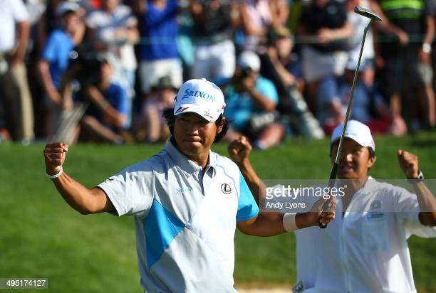 Hideki Matsuyama of Japan celebrates with his caddie after winning the Memorial Tournament presented by Nationwide Insurance in a playoff with Kevin...