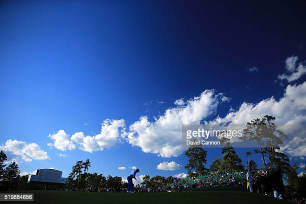 Hideki Matsuyama of Japan chips on the 18th green during the second round of the 2016 Masters Tournament at Augusta National Golf Club on April 8...