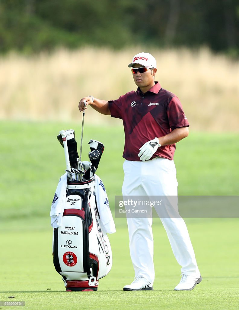 Hideki Matsuyama of Japan chooses his club for his second shot on the 12th hole during the second round of The Barclays in the PGA Tour FedExCup...