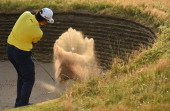 Hideki Matsuyama of Japan hits from a bunker on the 17th hole during the second round of The 143rd Open Championship at Royal Liverpool on July 18...
