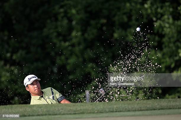 Hideki Matsuyama of Japan hits from a green side bunker on the first hole during the third round of the Arnold Palmer Invitational Presented by...