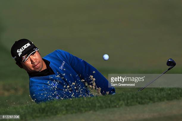 Hideki Matsuyama of Japan hits from a green side bunker on the third hole during the first round of the Honda Classic at PGA National Resort Spa...