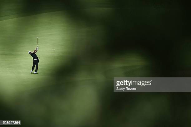 Hideki Matsuyama of Japan hits his approach shot on the 15th hole during the third round of the Wells Fargo Championship at Quail Hollow Club on May...